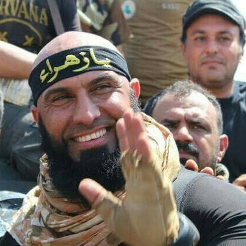 Pictures Purport to Show Iraqi Shia Militant Abu Azrael Slicing Burnt ISIS fighter