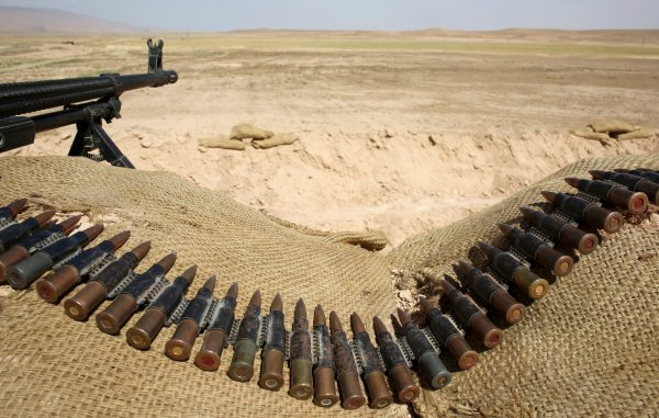 Bullets lie next to a gun at a Sinjar Resistance Units (YBS) check point, a militia affiliated with the Kurdistan Workers Party (PKK), in the village of Umm al-Dhiban, northern Iraq, April 30, 2016. REUTERS/Goran Tomasevic