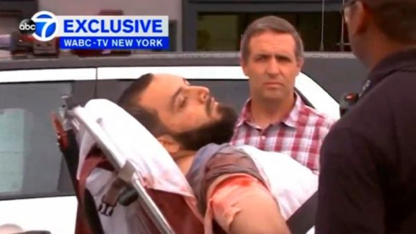 A still image captured from a video from WABC television shows a conscious man believed to be New York bombing suspect Ahmad Khan Rahami being loaded into an ambulance after a shoot-out with police in Linden, New Jersey, U.S., September 19, 2016. Courtesy WABC-TV via REUTERS