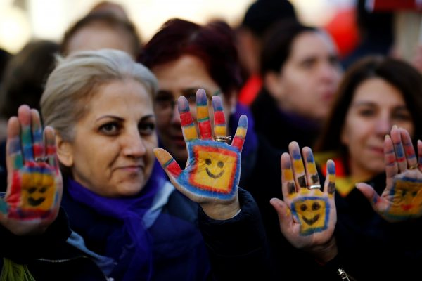 "Protesters show their painted hands during a protest against a proposal that would have allowed sentencing in cases of sexual abuse committed ""without force, threat or trick"" before Nov. 16, 2016 to be indefinitely postponed if the perpetrator marries the victim, in front of the Turkish Parlaiment in Ankara, Turkey, November 22, 2016. REUTERS/Umit Bektas"